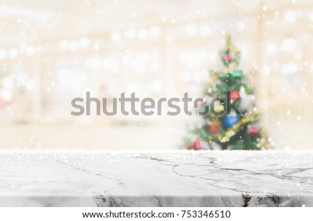 White marble stone table top on blur with bokeh christmas tree background with snowfall - can be used for display or montage your products. #753346510