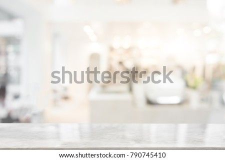 White marble table top on blur coffee shop window background. For product or foods montage. #790745410