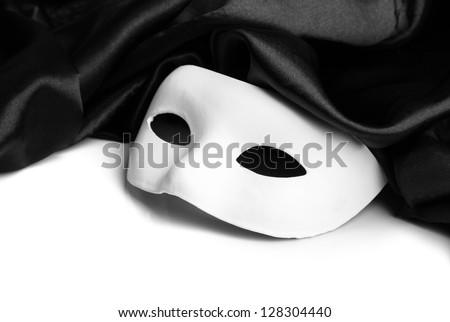 White mask and black silk fabric, isolated on white
