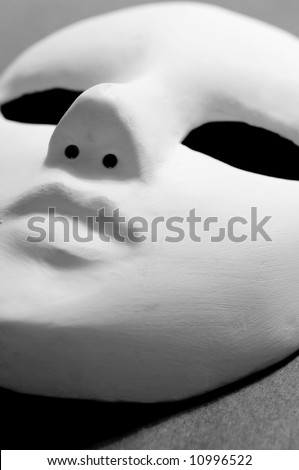 white mask for stage performance on black
