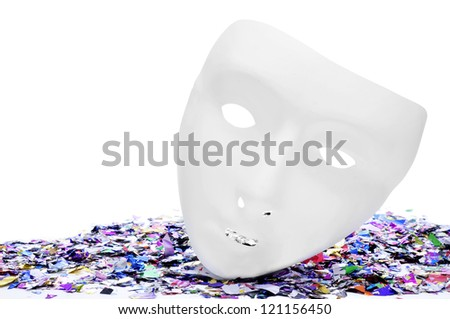 white mask on a pile of metallic confetti of different colors