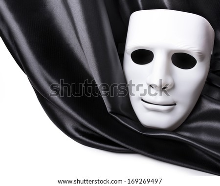 White mask on the black drapery