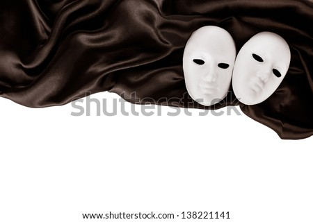 White masks and black silk fabric, isolated on white