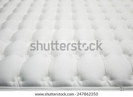 White mattress furniture store, real estate