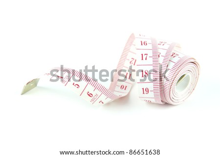 White measuring tape. The tape measure used for making clothing alterations and to measure body parts.