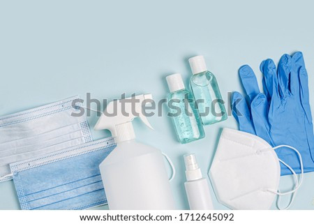 White medical masks and respirators with glove, hand sanitizer on blue background.  Face mask protection  KN95 or N95 and surgical masks for protection virus, flu, coronavirus, COVID-19.   Photo stock ©