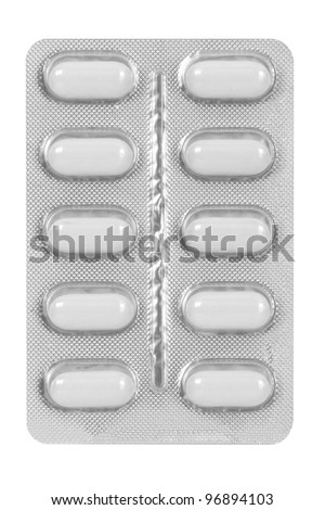 white medical pills in blister pack isolated on white background