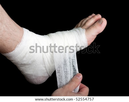 White medicine bandage on human injury foot
