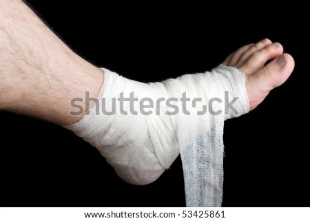White medicine bandage on human injury foot