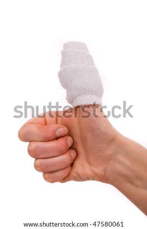 White medicine bandage on human injury hand finger. Studio isolated.