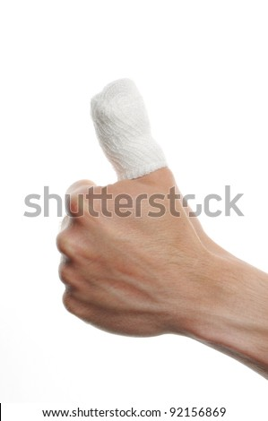 white medicine bandage on injury finger on white background