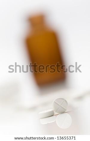 White medicine pills with medicine bottle