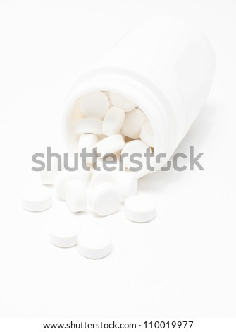 White medicines flow from container.