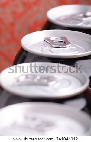 white metal beer cans background close up