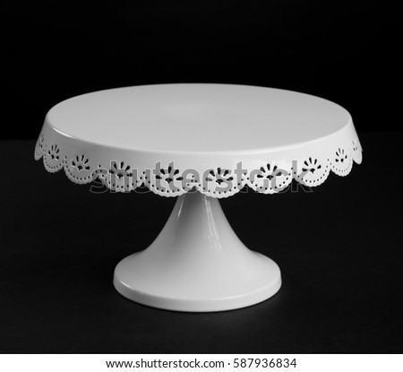 White metal cake stand on black background Foto stock ©