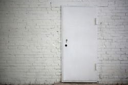 White metal door in white brick wall, horizontal picture