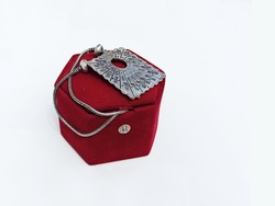 White metal ethnic necklace on red jewelry box. An Indian handicraft. A fashion accessory or gift item. Beautiful  jewel piece.White metals are alloys used as a base for plated silverware  ornaments.