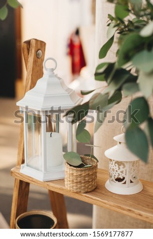 White metal lantern for candles, as well as elements of rustic decor in the decor of a wedding or home #1569177877