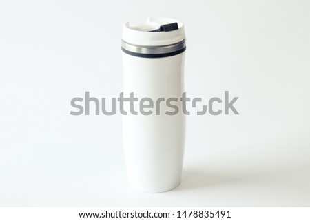 White metal travel mug with a place for your design on white background. Isolated. Mockup. Close up. Zero waste concept.