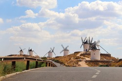White mills stand on the surrounding hills of Consuegra in Spain.The windmills that Don Quixote once fought with.