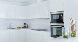 White minimalist kitchen. Decoration and interior design.