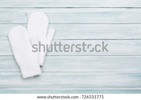 White mittens on wooden table. Christmas background. Top view with copy space #726331771