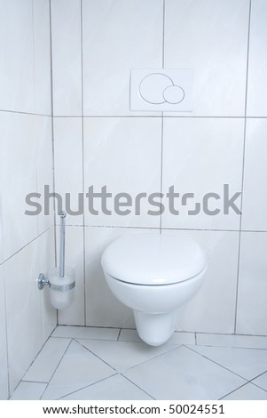 White, modern and clean toilet with brush. - stock photo