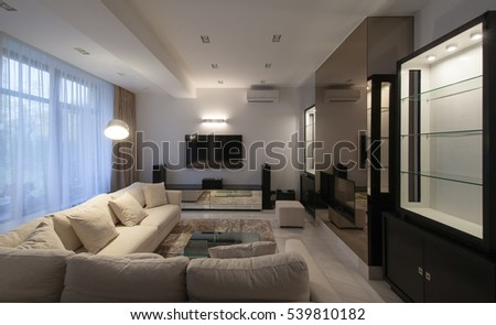Shutterstock White modern apartments in the evening with air conditioning and TV and long-transparent curtains