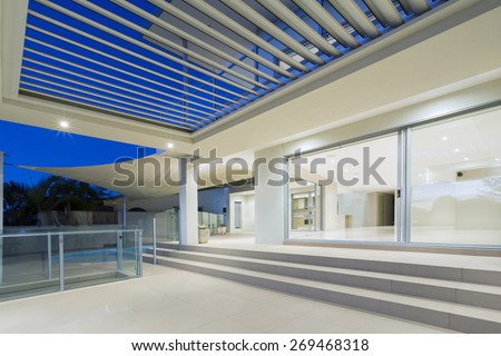 White modern luxurious mansion exterior with deck and swimming pool on the Gold Coast, Queensland Australia #269468318