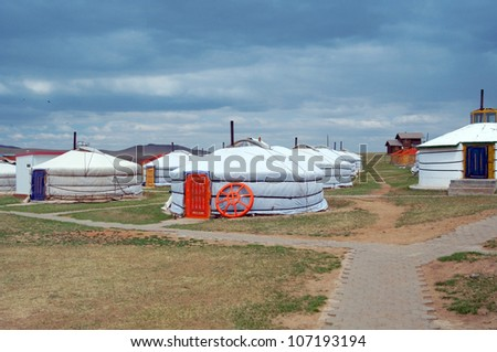 white Mongolian yurts in the Gobi Desert