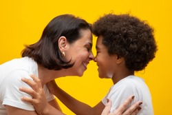 White mother with black son. Adoption Concept. Social respect, skin color, inclusion.