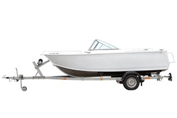 White motor boat isolated on the trailer for transportation.