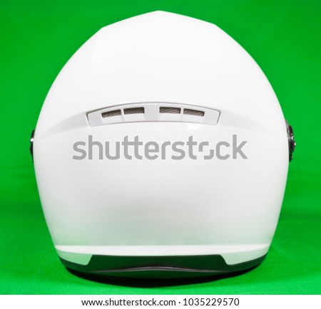 White motorcycle helmet, rear view, green background, back side