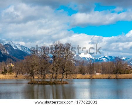 White mountain top and lake with a small izland Stock fotó ©