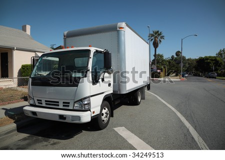 White moving truck on suburb street