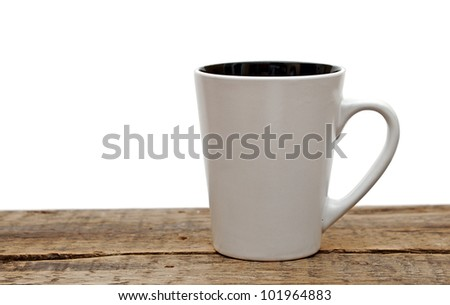 White mug empty blank for coffee  on a wooden table over white background