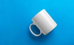 White mug mock-up on blue background