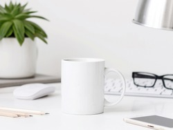White mug mockup on workdesk with keyboard desk lamp, mouse and pencils