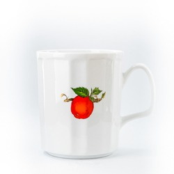 White mug on a white background with a painted berry.