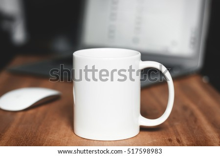 White mug on the desktop #517598983