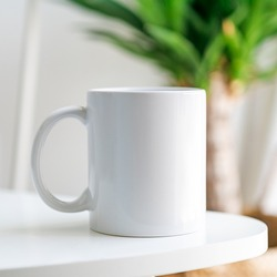 White Mug with copy space on front in lifestyle setting