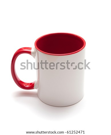 White mug with red handle isolated on white background