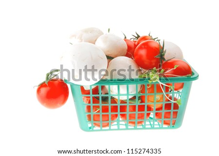 white mushroom and cherry in small green basket