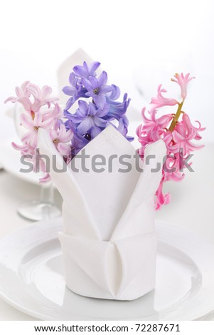 White napkin with hyacinth on white plate-table decoration