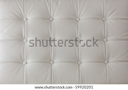 white natural leather upholstery of cushion on the modern chair