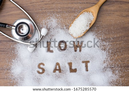 Photo of White natural sea salt and words