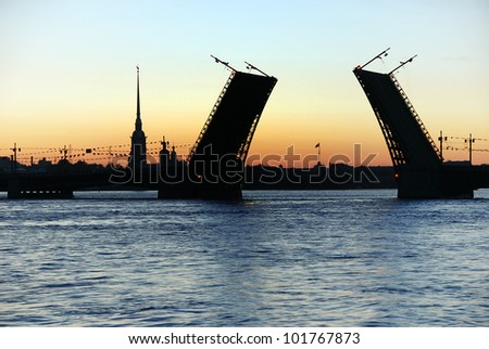 White nights. View of Neva river and raised Palace Bridge in St.Petersburg, Russia.