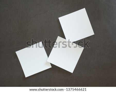White note paper placed on black cement floor #1375466621