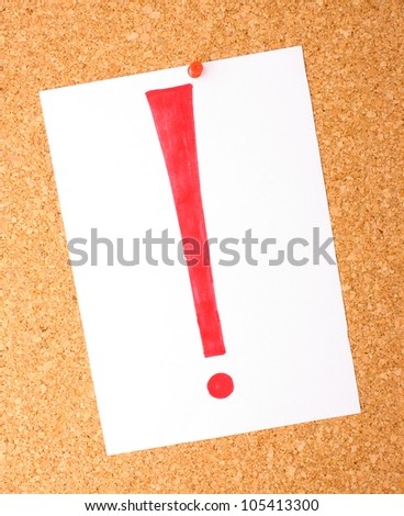 White note with exclamation mark on cork board