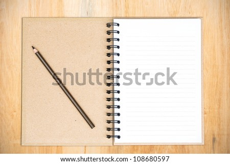 White notebook on wood with clipping path